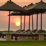 16. Atas Ombak Sunset and umbrellas